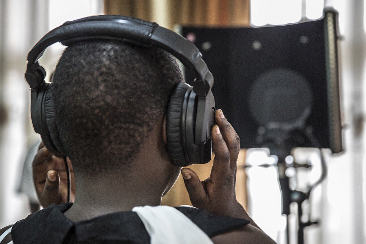 Make Music Matter. Youth holding headphones