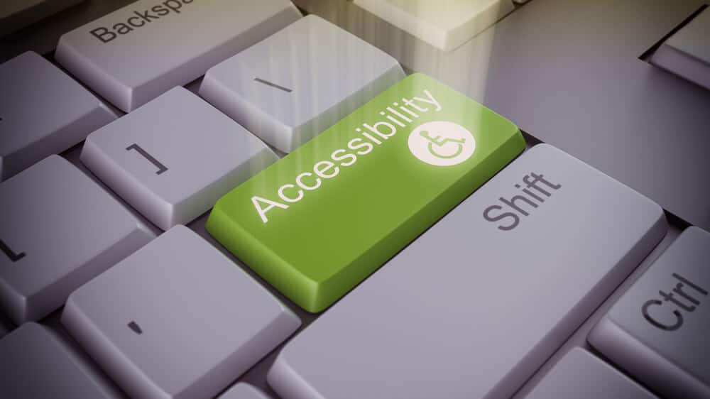 "Altered image of a keyboard with an ""accessibility"" button added and glowing."