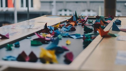 Photo by Dev Benjamin.  Colourful origami birds on table
